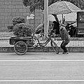 Woman is repairing her bike.jpg