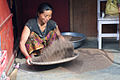 Woman preparing millet for making raksi (Nepalese whiskey) (4514934343).jpg
