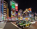 Yasukuni-dori Avenue at night with vehicles and colorful neon street signs, Shinjuku, Tokyo, Japan.jpg
