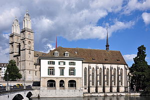 Wasserkirche - Grossmünster and Wasserkirche with Helmhaus (to the left) as seen from Stadthausquai, Münsterbrücke to the left.