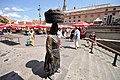"""Kumica"" – A peasant woman with woven basket on her head - Dolac Market (13024370094).jpg"