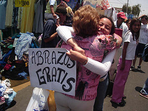 'FREE HUGS' in a marketplace, Chile