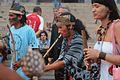 Índios dançando e tocando.jpg