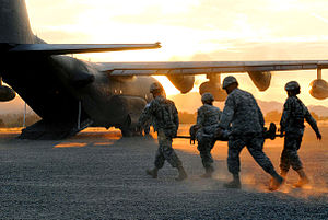 130th Rescue Squadron - Members of the 5502nd U.S. Army Hospital, in Denver, Colo., load a Soldier acting as a casualty onto a MC-130P cargo plane, flown by members of the California Air National Guard's 130th Rescue Squadron,