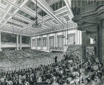 Meeting of the Anti-Corn Law League in Exeter Hall in 1846. 1846 - Anti-Corn Law League Meeting.jpg