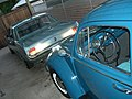 1966 Volkswagen Beetle with 1965 Ford Mustang (48909389057).jpg