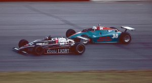 Pocono Raceway - Al Unser, Jr. (No. 7) and Chet Fillip (No. 38) racing at Pocono in 1984