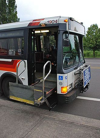 Wheelchair lift - A wheelchair lift in the front door of a city bus in Portland, Oregon, in 2010
