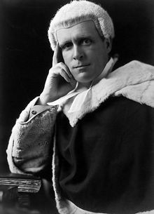 Formal photo of a judge in wig and robe