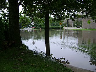 Kishwaukee River - The Kishwaukee River, fully crested at 15.2 feet, over Lucinda Avenue In DeKalb August 24th, 2007