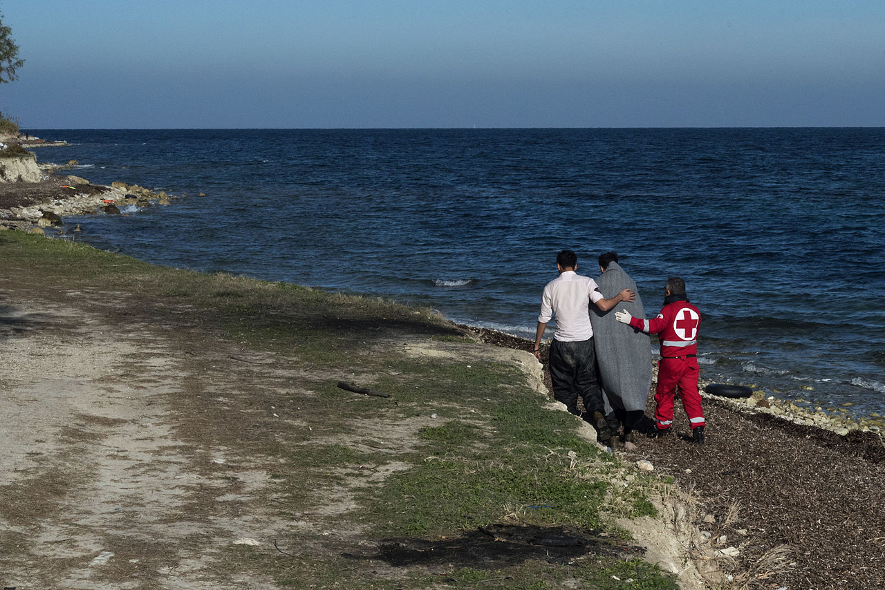 20151213 greek red cross helping an afghan refugee Mytilene Lesvos Greece.jpg