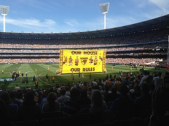 """2015 AFL Grand Final - Hawthorn's banner. The message, """"Our House, Our Rules"""", refers to the fact that the MCG is Hawthorn's home ground."""
