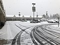 2018-03-21 09 18 08 View across the snow-covered parking lot at the Franklin Farm Village Shopping Center in the Franklin Farm section of Oak Hill, Fairfax County, Virginia.jpg