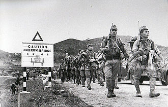 Japanese soldiers entering Hong Kong, 8 December 1941 228 regiment in HK.jpg