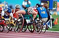 281000 - Athletics wheelchair racing Louise Sauvage action 2 - 3b - 2000 Sydney race photo.jpg