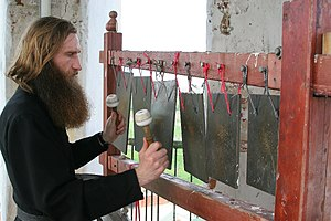 Semantron - A Russian monk playing a semantron