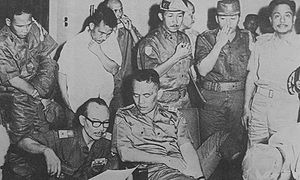 Abdul Haris Nasution - Nasution having his foot treated while discussing the situation at Kostrad HQ on the night of 1 October 1965