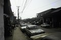 ASC Leiden - F. van der Kraaij Collection - 05 - 027 - A street view with parked cars in the business district - Monrovia, Montserrado, Liberia, 1975.tif