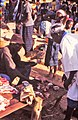 ASC Leiden - W.E.A. van Beek Collection - Dogon markets 45 - Pierre Pujugo buys meat with a butcher at the Tireli market, Mali 1989.jpg
