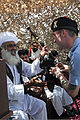 A British service member, right, shows his bagpipes to a village elder after performing at an Afghan Local Police (ALP) graduation ceremony at the regional ALP training center in the Lashkar Gah district 130606-A-RI362-121.jpg