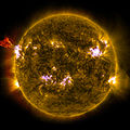A burst of solar material leaps off the left side of the sun in what's known as a prominence eruption.jpg