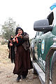 A female Afghan Uniform Police (AUP) officer practices safely approaching a vehicle at a checkpoint during AUP training at Combat Outpost Matun Hill, Khost province, Afghanistan 130225-A-PO167-274.jpg