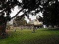 A verdant churchyard at All Hallows, Woolbeding - geograph.org.uk - 1739467.jpg