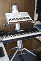 Access Virus TI2 Polar & Korg TR88 on stand.jpg
