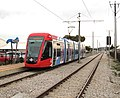 Adelaide Metro Citadis 302 tram from Glenelg at Morphett Road tram stop.jpg