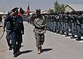 Afghan Brig. Generals Nasrullah Zarifi and Abdul Raziq salute an Afghan Honor Guard.jpg