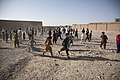 Afghan children run to their homes after the conclusion of a medical outreach program conducted by U.S. Soldiers Aug. 26, 2013, in Logar province, Afghanistan 130826-A-YX345-255.jpg