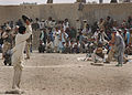 Afghan teens playing American baseball game.jpg