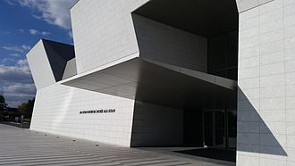Aga Khan Museum - White facade with dramatic entrance.