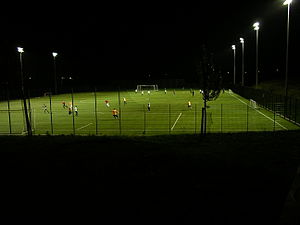 Floodlight - Football field at a sports centre illuminated with floodlights.