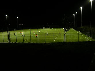 Floodlight - Association football field at a sports centre illuminated with floodlights.