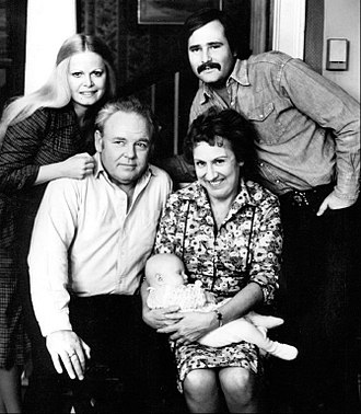 All in the Family - The Bunkers and the Stivics: standing, Gloria (Sally Struthers) and Michael (Rob Reiner); seated, Archie (Carroll O'Connor) and Edith (Jean Stapleton) with baby Joey