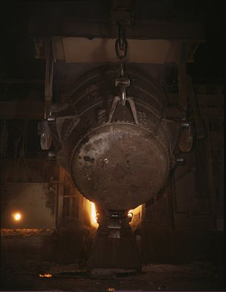 Ladle (metallurgy) - A ladle of molten iron is poured into an open hearth furnace for conversion into steel at Allegheny Ludlum Steel Corp., 1941