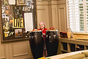 St. Jude Children's Research Hospital - A child playing congas in the Amy Grant Music Room at St. Jude Children's Research Hospital