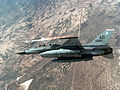 An F-16 Fighting Falcon aircraft fires an AIM-9P4 Sidewinder missile at an MQM-107 target drone DF-SC-90-00302.jpg