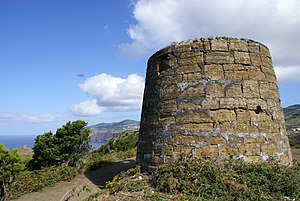 Velas - The ruins of an old windmill, located on the Morro das Velas, along the south-west coast of the village of Velas