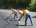 Ashland maintenance crews help repair the MP 12 slide (35720487236).jpg