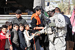Automatic Soldiers Give to Iraqis During Holiday Season DVIDS70400.jpg