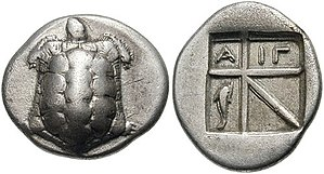 History of money - Greek drachm of Aegina. Obverse: Land turtle / Reverse: ΑΙΓ(INA) and dolphin. The oldest turtle coin dates 700 BCE; this coin: after 404 BCE