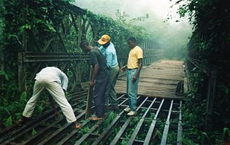 Basankusu - Arranging planks of wood to enable passage of this decaying Bailey Bridge.