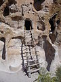 Bandelier National Monument in September 2011 - Cliff Dwellings - cavate with modern ladder at stop 11.JPG