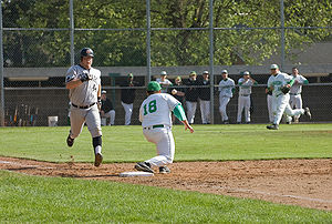 "First baseman - A high school first baseman takes a throw from the third baseman in an attempt to have the runner called ""out""."