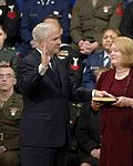 Becky Gates holds the bible as Robert M. Gates is sworn in as the 22nd secretary of defense, December 2006.jpg