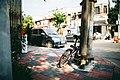 Bike parked on corner of street (Unsplash).jpg