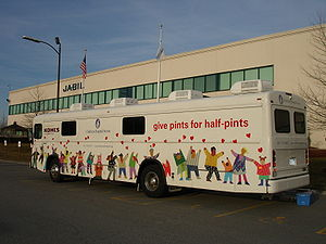 Donation - A blood collection bus (bloodmobile) from Children's Hospital Boston at a manufacturing facility in Massachusetts: Blood banks sometimes use a modified bus or similar large vehicle to provide mobile facilities for donation.