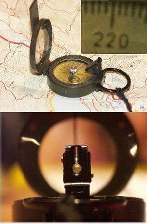 Hand compass - Floating-card compass with prismatic sight (bearing 220° through eyepiece)